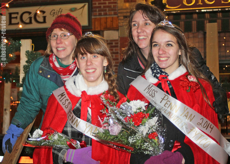 The 2013 Miss Penn Yan Hannah Gaston (left) and the newly selected 2014 Miss Penn Yan Abigail Blauvelt pose with their mothers after StarShine Friday, Dec. 6.