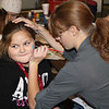 Aryan Bentley gets her face painted by Amber Mason at the Elf School held at the Pen nYan Fire Department.