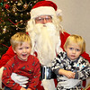 Wilkins Fuller (left) and Trevan Drake (right) visit Santa Claus during Penn Yan's annual StarShine celebration Friday, Dec. 6.