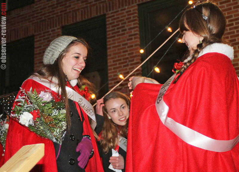 Abigail Blauvelt (left) was selected as the 2014 Miss Penn Yan during the StarShine celebration Friday, Dec. 6. Pictured above, the 2013 Miss Penn Yan Hannah Gaston (right) presents Blauvelt with her sash and tiara.