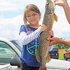 Jaelea Tietjen, 7, hoists her first place five pound, 13 ounce pike during the Eighth Annual Youth Fishing Derby on Keuka Lake Saturday, June 29. Tietjen also caught a four pound, two ounce smallmouth bass. Other categories included panfish, carp, bullhead and trout. Every contestant who placed first, second or third was able to select a prize at the end of the contest.