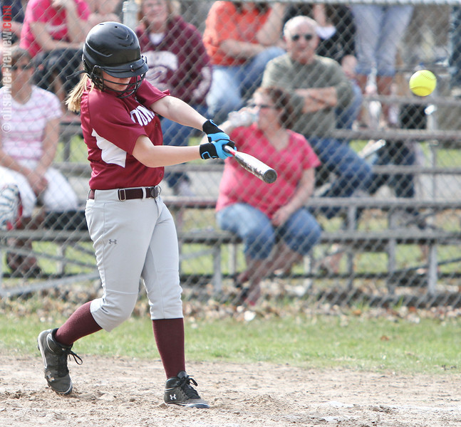 Ayla Lane drives the ball to the outfield for a run scoring double, Monday evening.