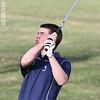 Keith Rekczis chips at the Watkins Glen Golf Course, Monday, April 21.