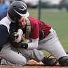 Watkins Glen's Sam Pulis is stopped at the plate by Odessa catcher Dylan Porter last week. He was called out.