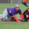 Hammondsport's Chris Beers tags out Dundee's Paul Pollack at third base last weekend.