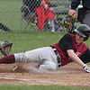 Dundee's Austin Spina slides safely into home base during the game Saturday, April 26.