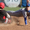 Penn Yan's Noah Hullings dives for the ball at second base as a runner slides in, Thursday, April 24.