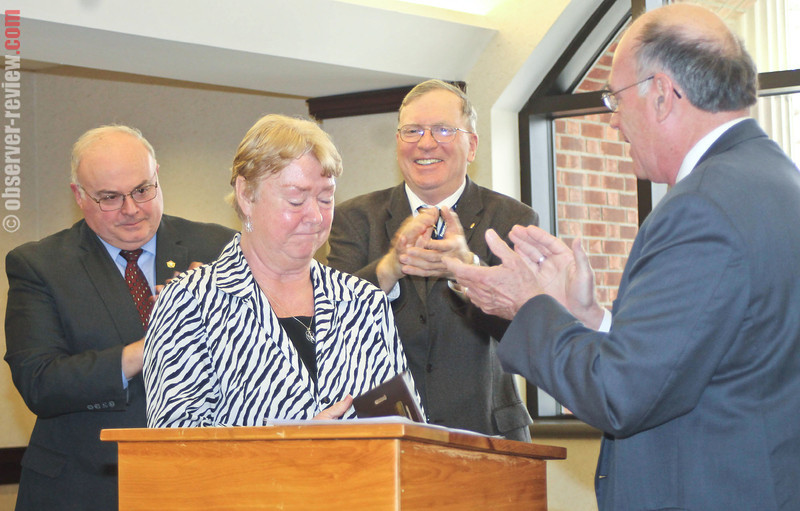 Yates County recognized Crime Victims Awareness Week with a ceremony Wednesday, April 9 in the Yates County Courthouse. Pictured from left to right, Yates County Sheriff Ron Spike applauds the Yates County Adult Treatment Court Director Evelyn Watkins as County Chairman Tim Dennis and Judge Patrick Falvey present her with an award for her years of service helping the victims of crime.