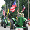 Crowds lined the four corners area in Branchport for the annual Independence Day Parade Monday, July 4. The parade featured several different participants including tractors, fire trucks, political candidates and various groups who were waving flags and throwing candy to those watching along the roadside.