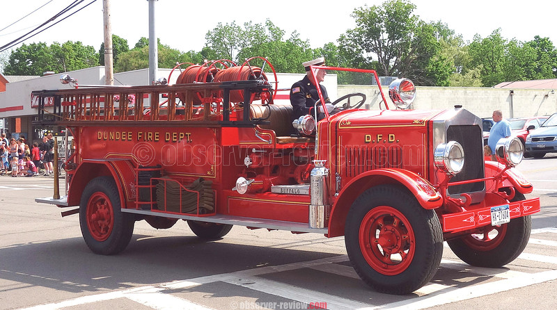 One of the entries in the Dundee parade was a vintage fire truck driven by Ray Miller.
