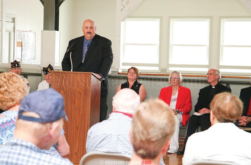 Keynote speaker Kevin Rumsey speaks at the Watkins Glen Community Center service, Monday morning.