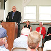 Keynote speaker Kevin Rumsey speaks at the Watkins Glen Community Center service, Monday morning.