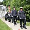 The Montour Falls Fire Department color guard marches at the conclusion of the event at the falls park.