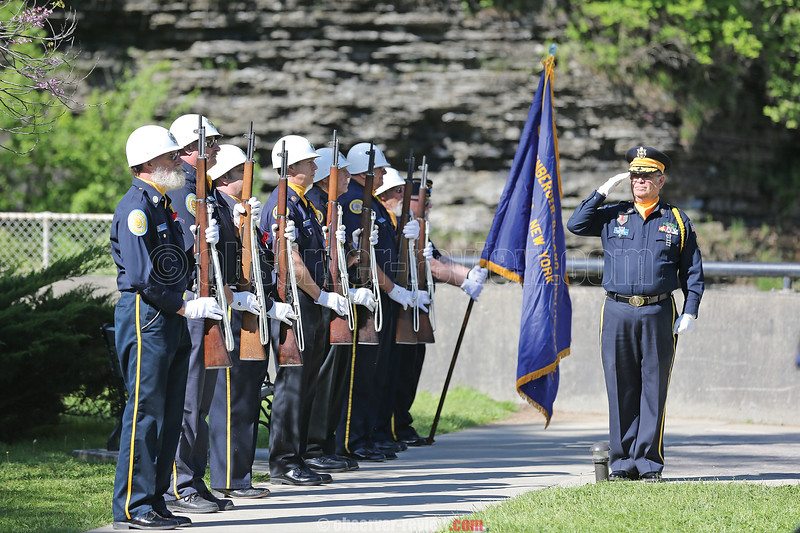 American Legion Commander Rick Lewis (right) leads the gun salute in Montour Falls.