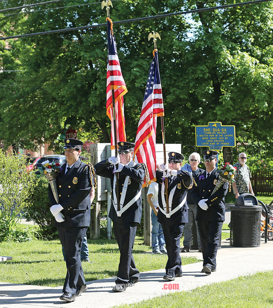 The Montour Falls Fire Department color guard marches at the beginning of the Montour Memorial Day ceremony.
