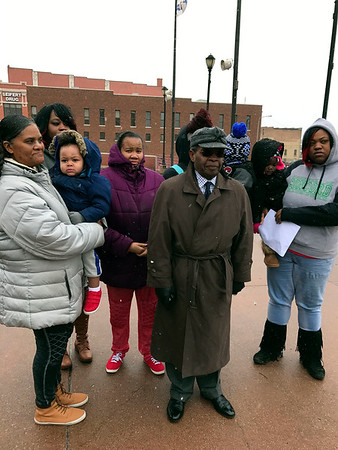 SHERRY VAN ARSDALL | THE GOSHEN NEWS Family members of Norman Gary, who was fatally shot by two Elkhart police officers, gather with their attorney Douglas Grimes during a prayer vigil in Elkhart Saturday to pray as a grand jury convenes on Monday.