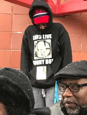 SHERRY VAN ARSDALL | THE GOSHEN NEWS Adrianna  Wilson wears a hoodie during a prayer vigil in Elkhart Saturday as a grand jury convenes in the death of her uncle, Norman Gary, who was fatally shot by two Elkhart police officers.
