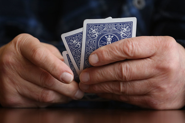 JAY YOUNG | THE GOSHEN NEWS Joe Lehman holds his cards close  while waiting for his turn during a weekly Euchre game Wednesday morning at Gaining Grounds.  Lehman has been playing since 2008, when his family moved away and he needed a new group to play with.