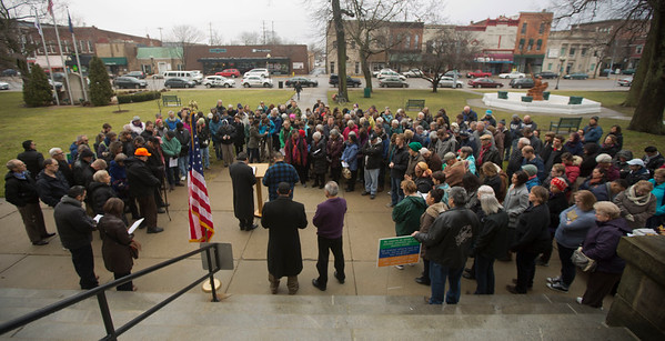 JAY YOUNG | THE GOSHEN NEWS A large group gathers for a prayer gathering on the lawn of the Elkhart County Courthouse in downtown Goshen on Friday afternoon. The event, which was organized by Elkhart County HOPE (Helping Our People Everywhere), was scheduled to coincide exactly with the time that Donald J. Trump was sworn in as the nation's 45th president. At the event, members of the community offered prayers and songs aimed at bringing everyone together and offering hope for all.