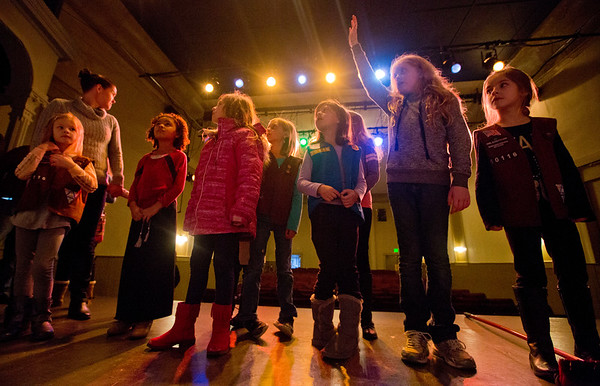 JAY YOUNG | THE GOSHEN NEWS Standing on the stage of the 120 year old Elkhart Civic Theater, nine-year-old Grace Rippy, of Granger, raises her hand to ask a question about the theater Thursday evening in Bristol. Rippy, a member of Girl Scout Troop 50116, was touring the theater with the scouts to learn more about it.