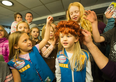 JAY YOUNG | THE GOSHEN NEWS Six-year-old Harper Glotzbach, center, checks herself out in a backstage mirror as she tries on a costume wig while others, including five-year-old Juno Brownewell, left, touch the wig Thursday evening at the Elkhart Civic Theater in Bristol. The girls, all members of Girl Scout Troop 50116, were touring the 120 year old theater to learn more about it.
