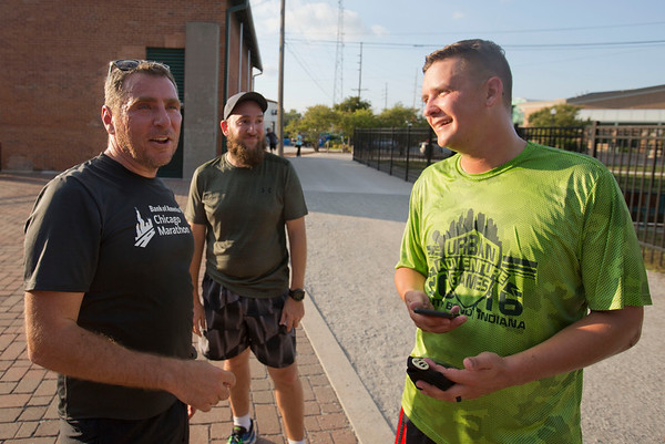 JAY YOUNG | THE GOSHEN NEWS<br /> Runners Steve Freeto, of Goshen, Jordan Rhude, of Elkhart, and Tyler Miller, of Goshen, chat following The Goshen Brewery Company's weekly Goshen Millrace Dam Beer Run Thursday evening. Every Thursday at 6 p.m. runners meet outside the brewery and run to the dam and back, about four miles. Afterwards, the runners meet up and enjoy drinks at the brewery. The runs are free and open to the public.