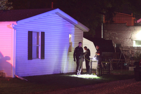 ROGER SCHNEIDER | THE GOSHEN NEWS<br /> Elkhart County police investigate a shooting in New Paris Thursday night.