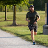 JAY YOUNG | THE GOSHEN NEWS<br /> Jordan Rhude, of Elkhart, runs down the Millrace Trail during The Goshen Brewery Company's weekly Goshen Millrace Dam Beer Run Thursday evening. Every Thursday at 6 p.m. runners meet outside the brewery and run to the dam and back, about four miles. Afterwards, the runners meet up and enjoy drinks at the brewery. The runs are free and open to the public.
