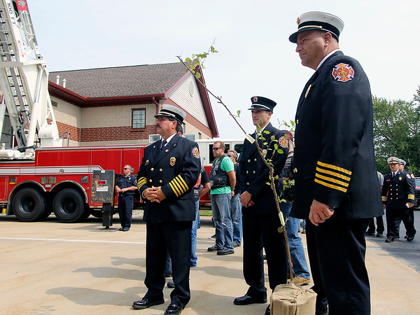 ADAM RANDALL   THE GOSHEN NEWS<br /> Goshen Fire Department Chief Dan Sink, fire inspector Matt Stamm and Assistant Fire Chief Mike Happer stand with a commorative 9/11 sapling at a ceremony Monday at Concord Fire Station No. 1 on C.R. 18.