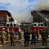 JAY YOUNG | THE GOSHEN NEWS<br /> Firefighters work to bring a large fire under control in downtown LaGrange Tuesday afternoon.