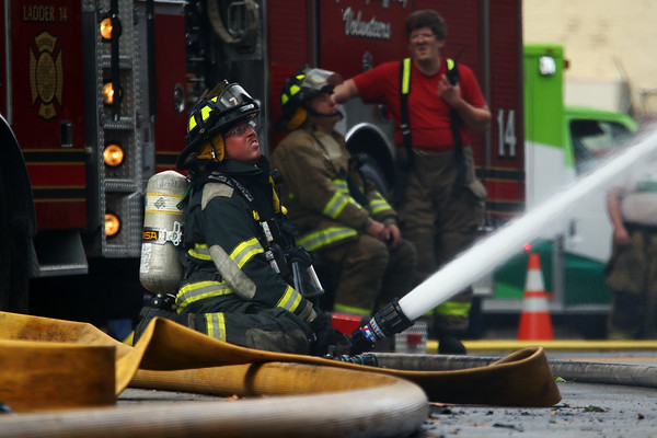 JAY YOUNG | THE GOSHEN NEWS<br /> A firefighter mans a hose at the scene of a large fire in downtown LaGrange Tuesday afternoon.