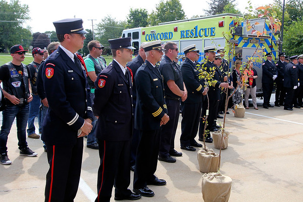 ADAM RANDALL   THE GOSHEN NEWS<br /> Fire department representatives from Goshen, Elkhart, Nappanee, Jefferson Township, Osolo Township, Baugo Township, South Bend and Notre Dame, were presented trees at Concord Fire Department No. 1's 9/11 ceremony Monday.