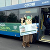 Hudson Valley Community College mascot Viking carries a large student ID preparing to board a CDTA bus after the college and CDTA team up to provide free bus passes to HVCC students Monday, August 26, 2013 at the college in Troy, N.Y.. (J.S.CARRAS/THE RECORD)