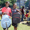 Anthony Williams 9, and Jamill Taylor 13, received new backpack/school supplies during free community meal, backpack/school supplies give-a-way at Bethel Baptist ChurchSaturday, August 24, 2013 in Troy, N.Y.. (J.S.CARRAS/THE RECORD)