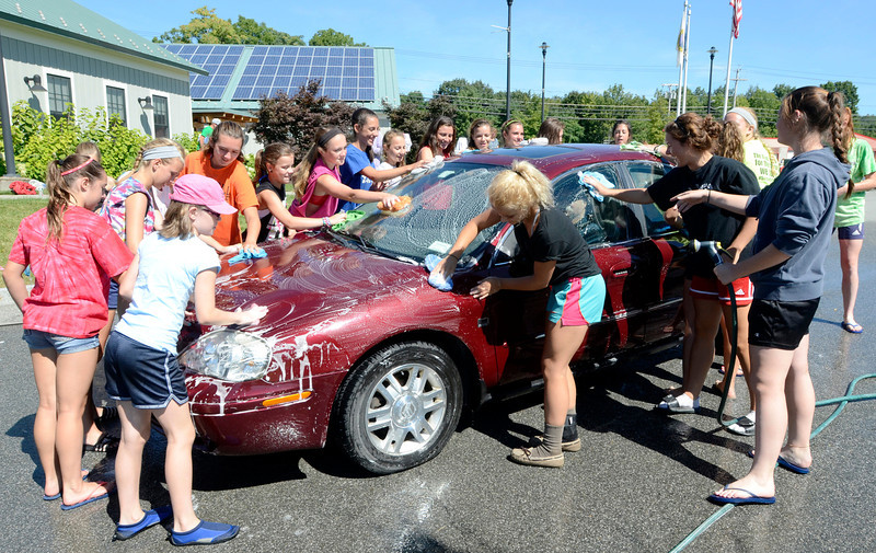 Members of Tamarac athletic teams wash cars at Brunswick Town Hall Saturday, August 24, 2013  as a fundraiser for Tamarac Booster Club in Brunswick, N.Y.. (J.S.CARRAS/THE RECORD)