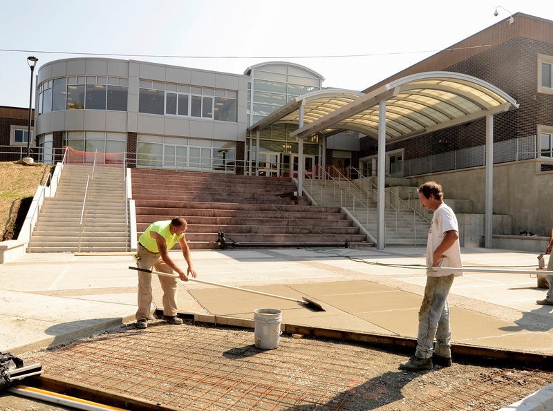 Sidewalks being poured. Renovations to the Doyle Middle School in Troy. Wednesday 08/28/13 (Mike McMahon/The Record)