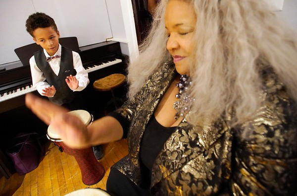 BEN GARVER — THE BERKSHIRE EAGLE<br /> Spencer Mathias Reed, 8, and Wanda Houston drum during a drumming circle led by Otha Day  at The Women of Color Giving Circle of the Berkshires annual Kwanzaa Celebration at the Whitney Center for the Arts in Pittsfield, Friday December 28, 2018.