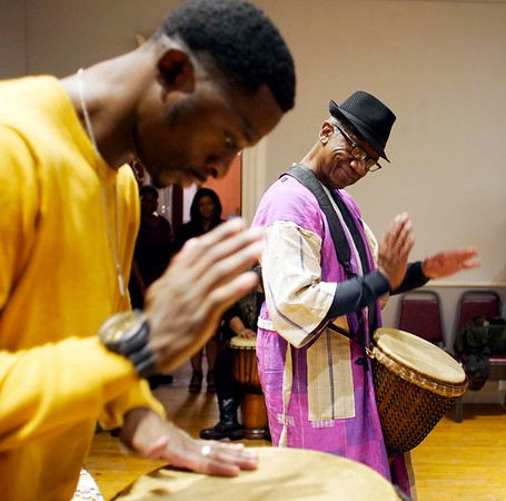 BEN GARVER — THE BERKSHIRE EAGLE<br /> Otha Day (background) leads a drumming circle with Gerald Hill at The Women of Color Giving Circle of the Berkshires annual Kwanzaa Celebration at the Whitney Center for the Arts in Pittsfield, Friday December 28, 2018.
