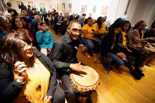BEN GARVER — THE BERKSHIRE EAGLE<br /> T Lance Black (center) drums during a drumming circle led by Otha Day  at The Women of Color Giving Circle of the Berkshires annual Kwanzaa Celebration at the Whitney Center for the Arts in Pittsfield, Friday December 28, 2018.
