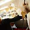 KRISTOPHER RADDER - BRATTLEBORO REFORMER<br /> Madan Rathore, the owner of India Masala House, pulls chicken off a hot skewer for a chicken aamwala dish.
