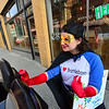 KRISTOPHER RADDER - BRATTLEBORO REFORMER<br /> Cassandra Dunn dressed as the Brattleboro Parking Hero puts quarters into the parking meters on Flat Street, in Brattleboro, on Friday, May 4, 2018. The parking was paid by the Downtown Brattleboro Alliance. There are plans for the hero to return to the streets of Brattleboro another four times in 2018.