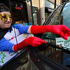 KRISTOPHER RADDER - BRATTLEBORO REFORMER<br /> Cassandra Dunn dressed as the Brattleboro Parking Hero places a note onto a car that she saved from a ticket on Friday, May 4, 2018. The parking was paid by the Downtown Brattleboro Alliance. There are plans for the hero to return to the streets of Brattleboro another four times in 2018.