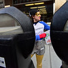 KRISTOPHER RADDER - BRATTLEBORO REFORMER<br /> Cassandra Dunn dressed as the Brattleboro Parking Hero puts quarters into the parking meters on Main Street, in Brattleboro, on Friday, May 4, 2018. The parking was paid by the Downtown Brattleboro Alliance. There are plans for the hero to return to the streets of Brattleboro another four times in 2018.