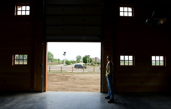 "Jeff Moline,  Thomas Open Space Project Manager, looks out the north door of the barn.<br /> Thomas Open Space Barn will serve as a storefront for Isabelle Farms, which farms the 14 acres of OS the city bought in 2005 with organic crops. The city holds a big opening ceremony on Friday, June 1 and the barn officially opens for business at the end of June.<br /> For a video of the barn, go to  <a href=""http://www.dailycamera.com"">http://www.dailycamera.com</a>.<br /> Cliff Grassmick / May 25, 2012"