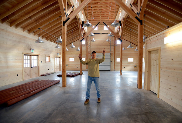 """Jeff Moline,  Thomas Open Space Project Manager, points out some of the features inside the barn.<br /> Thomas Open Space Barn will serve as a storefront for Isabelle Farms, which farms the 14 acres of OS the city bought in 2005 with organic crops. The city holds a big opening ceremony on Friday, June 1 and the barn officially opens for business at the end of June.<br /> For a video and more photos of the barn, go to  <a href=""""http://www.dailycamera.com"""">http://www.dailycamera.com</a>.<br /> Cliff Grassmick / May 25, 2012"""