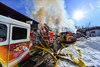 KRISTOPHER RADDER - BRATTLEBORO REFORMER Several firefighting crews responded to a three-alarm fire at 55 Brisk Lane in Brattleboro on Tuesday, Feb. 21, 2017. The fire, which was first called in at 7:58 a.m., was updated to a third alarm at 8:10 a.m.  Crews shutdown a section of Putney Road as they tap various hydrants to help battle the blaze.