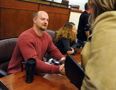 Tim Masters, left, meets supporters from the audience at the CU Law School after his panel discussion. Tim Masters and his post-conviction attorney, Maria Lui, spoke at the University of Colorado Law School on October 13, 2011. The program was sponsored by the Colorado Innocence Project. Masters spent years in prison for a crime he did not commit.  For more photos and a video, go to www.dailycamera.com. Cliff Grassmick / October 13, 2011