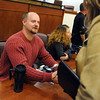 "Tim Masters, left, meets supporters from the audience at the CU Law School after his panel discussion.<br /> Tim Masters and his post-conviction attorney, Maria Lui, spoke at the University of Colorado Law School on October 13, 2011. The program was sponsored by the Colorado Innocence Project. Masters spent years in prison for a crime he did not commit.<br />  For more photos and a video, go to  <a href=""http://www.dailycamera.com"">http://www.dailycamera.com</a>.<br /> Cliff Grassmick / October 13, 2011"
