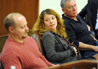 Attorney Maria Lui, center, responds to questions at the panel discussion. Tim Masters and his post-conviction attorney, Maria Lui, spoke at the University of Colorado Law School on October 13, 2011. The program was sponsored by the Colorado Innocence Project. Masters spent years in prison for a crime he did not commit.  For more photos and a video, go to www.dailycamera.com. Cliff Grassmick / October 13, 2011