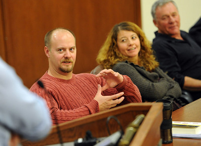 Tim Masters, left, answers questions from the audience at the CU Law School. Tim Masters and his post-conviction attorney, Maria Lui, spoke at the University of Colorado Law School on October 13, 2011. The program was sponsored by the Colorado Innocence Project. Masters spent years in prison for a crime he did not commit.  For more photos and a video, go to www.dailycamera.com. Cliff Grassmick / October 13, 2011